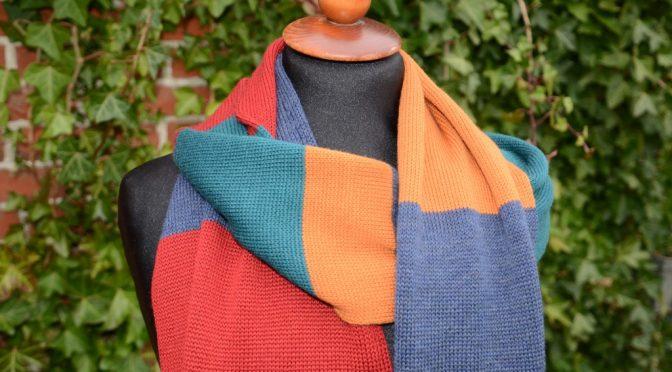 Opskrift på rundstrikket tørklæde er blevet rettet